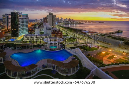 Aerial view over Punta Del Este and Atlantic Ocean on sunset. Uruguay. #647676238