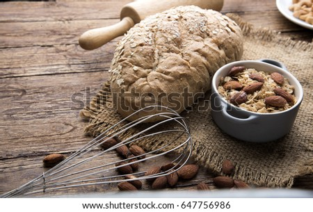 Different kinds of bread rolls on black board from above. Kitchen or bakery poster design. #647756986