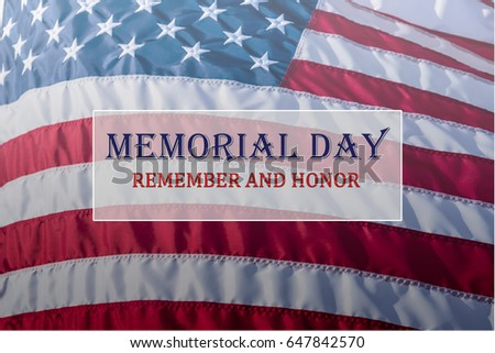 Text Memorial Day and Honor on flowing American flag background. Concept of Memorial day or Veteran's day in America. #647842570