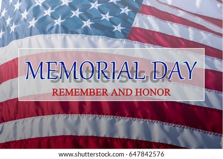 Text Memorial Day and Honor on flowing American flag background. Concept of Memorial day or Veteran's day in America. #647842576