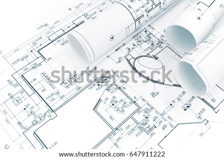 architectural background with rolls of technical drawings and blueprints #647911222