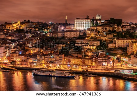 Porto, Portugal: and the old town and Douro river at night  #647941366
