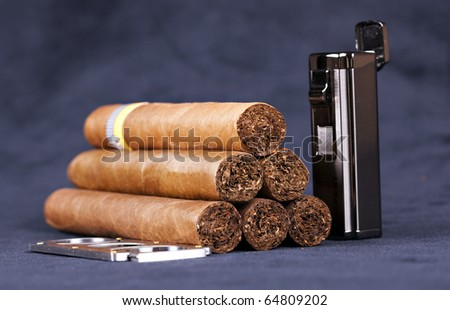 Cuban top cigars with lighter and cutter Royalty-Free Stock Photo #64809202