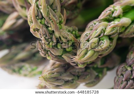 closeup to raw green asparagus #648185728