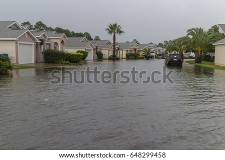 Flooded neighborhood streets #648299458