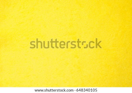 Texture background pattern. Woolen yellow fabric, cloth for a blanket, outer clothing.  Closeup horizontal fragment #648340105