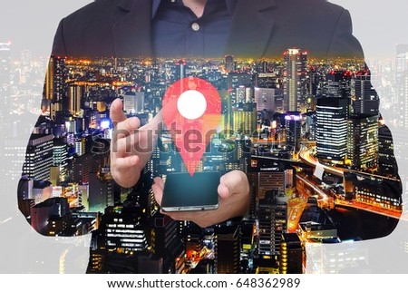 Double exposure - businessman hold smartphone and show the location pin symbol #648362989