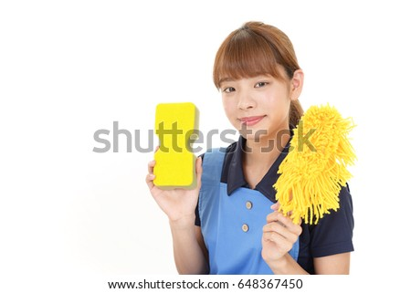 Woman with cleaning tools #648367450