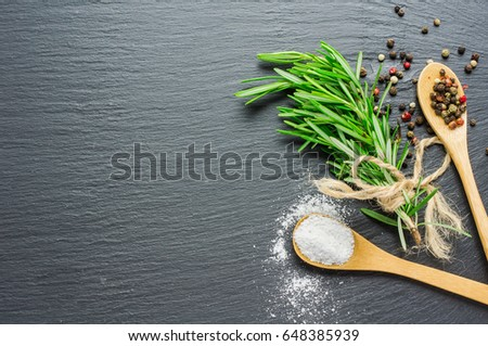 Fresh rosemary spice on dark wooden board with copyspace #648385939