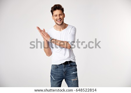 Handsome young guy posing in studio - isolated #648522814