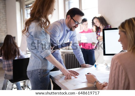 Business coworkers discussing new ideas and brainstorming in office #648619717