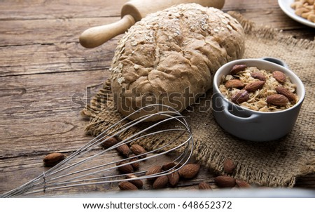 Assortment of baked bread on wooden table background #648652372