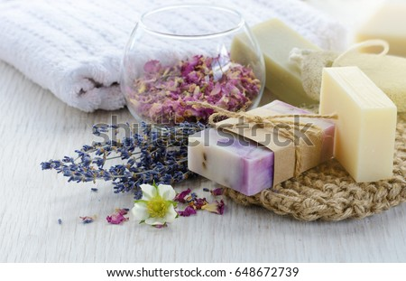 Handmade Soap with bath and spa accessories. Dried lavender and rose petals Royalty-Free Stock Photo #648672739