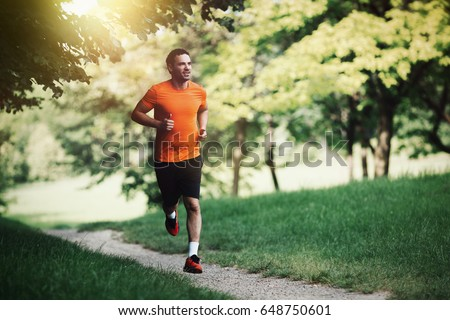 Active healthy runner jogging outdoor Royalty-Free Stock Photo #648750601
