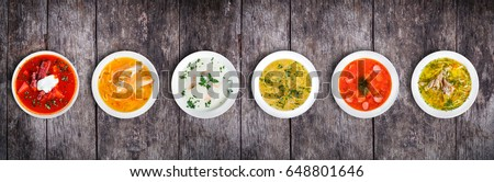 Set of soups from worldwide cuisines, healthy food. Cream soup with mushrooms, asian fish soup, soup with meat - solyanka, russian borscht, chicken soup on rustic wooden background. Top view #648801646