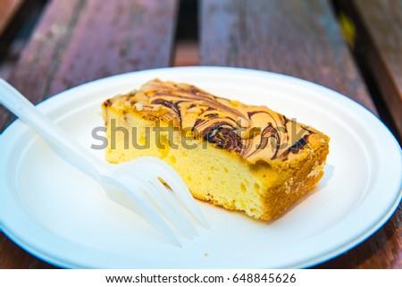Macadamia Marble Cake on White Plate, Thailand. #648845626
