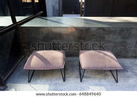 Modern chairs with cement counter in coffee shop #648849640