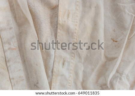 Closeup image of very old rusty white shirt texture for background use #649011835