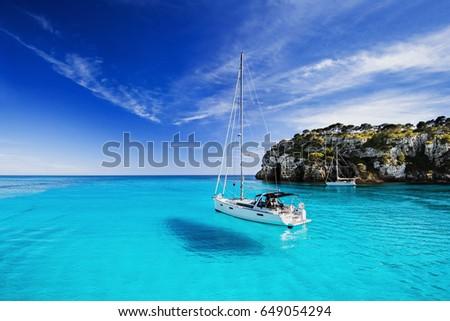 Beautiful bay with sailing boats, Menorca island, Spain Royalty-Free Stock Photo #649054294
