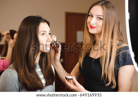 Make up artist doing professional make up of young woman. Beauty shcool. #649169935