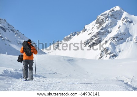 Hiking in snowshoes along the mountain track #64936141