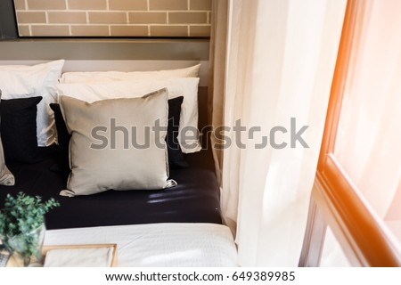Bed maid-up with clean white pillows and bed sheets in beauty room. Close-up. Lens flair in sunlight. #649389985