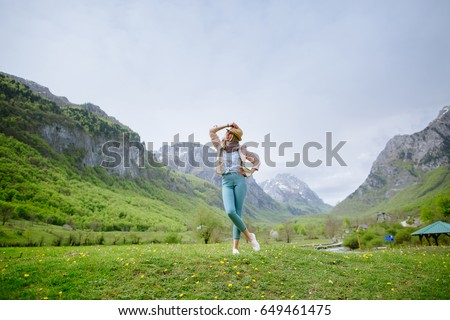 joyful woman travel mountains. Authentic blonde female relax in picturesque landscape. Montenegro, Prokletije #649461475