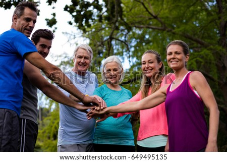 Group of people doing a hand stack in park #649495135