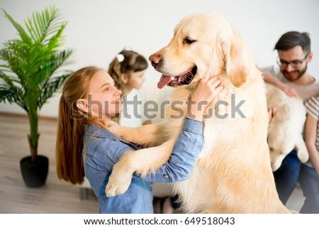 Family playing with a dog #649518043