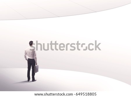 Young sales business person in elegant suit standing with his back in empty white space background with curved lines concept #649518805