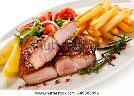 Roast steak with french fries on white background #649586896