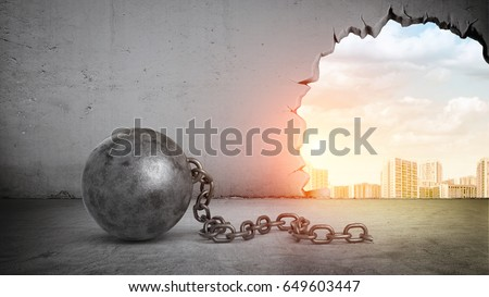 A black wrecking ball and hole in a concrete wall showing city landscape. Old building demolition. New construction site. Freshen up your life. Royalty-Free Stock Photo #649603447