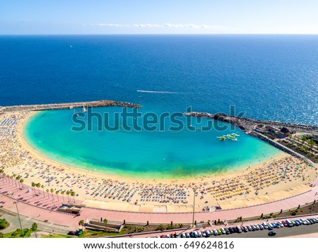 Beautiful aerial view of Playa de Amadores beach on the Gran Canaria island in Spain. Gorgeous sea shore of the Canary islands. Royalty-Free Stock Photo #649624816