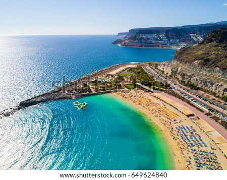 Beautiful aerial view of Playa de Amadores bay with other cliffs on the sea shore on the Gran Canaria island in Spain. Gorgeous sea shore of the island. Royalty-Free Stock Photo #649624840