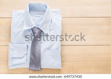 shirt with necktie - selective focus point #649737430