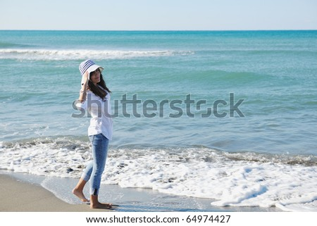 happy young woman relax onbeautiful  beach at morning #64974427