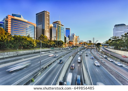 Wide view of multi lane Warringah freeway going through North SYdney during morning rush hour traffic peak and congestion in Australia. Royalty-Free Stock Photo #649856485