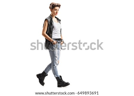 Full length portrait of a punk girl walking isolated on white background #649893691