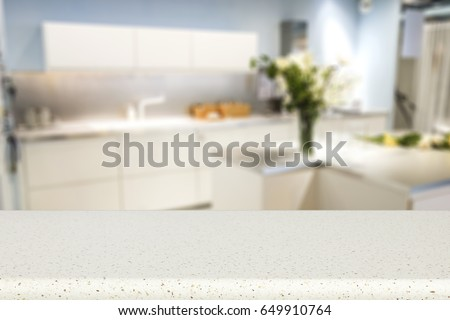 table background of white color and blurred interior of kitchen place  #649910764