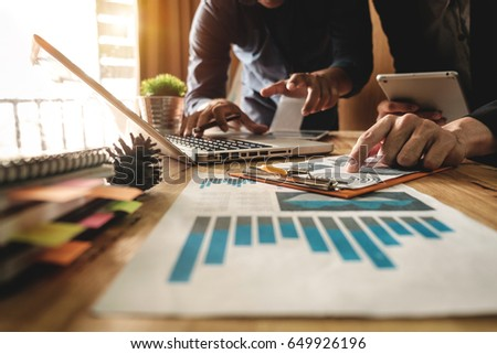 Business team meeting. Photo professional investor working new start up project. Finance task. Digital tablet docking keyboard laptop computer smart phone in morning light Royalty-Free Stock Photo #649926196