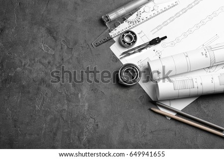 Engineering supplies and part blueprints on workplace Royalty-Free Stock Photo #649941655