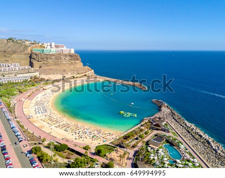 Beautiful aerial view of the full Playa de Amadores bay beach on Gran Canaria island in Spain. Royalty-Free Stock Photo #649994995