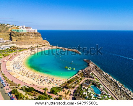 Beautiful stunning aerial view of the Playa de Amadores beach on Gran Canaria island in Spain near Tenerife island. Royalty-Free Stock Photo #649995001