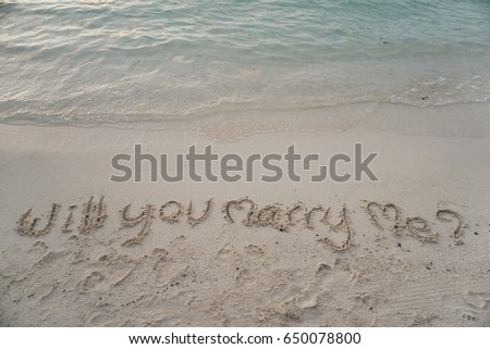 """wording """"Will you marry me?"""" write on sand #650078800"""
