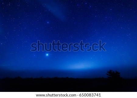 The planet Jupiter in the starry sky through the fog. #650083741
