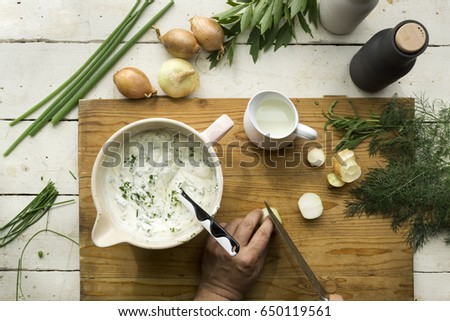 Homemade Herb Curd in bowl (close-up shot) on vintage wooden background #650119561