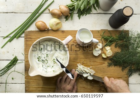 Homemade Herb Curd in bowl (close-up shot) on vintage wooden background #650119597