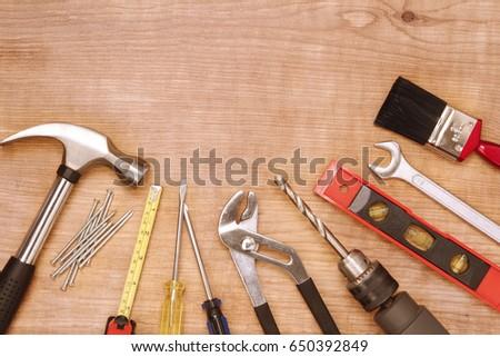 Assorted work tools on wood #650392849