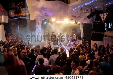 Odessa, Ukraine September 1, 2013: Ibiza night club. Night club dj party people enjoy of music dancing sound with colorful light with Smoke Machine and lights show. Hands up in the earth. #650431795