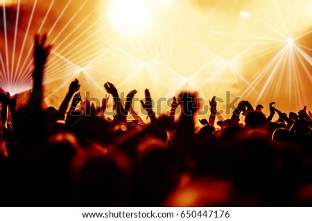 cheering crowd at a rock concert #650447176
